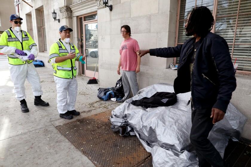LOS ANGELES, CALIF. -- MONDAY, APRIL 8, 2019: City of Los Angeles sanitation hazmat workers inform h