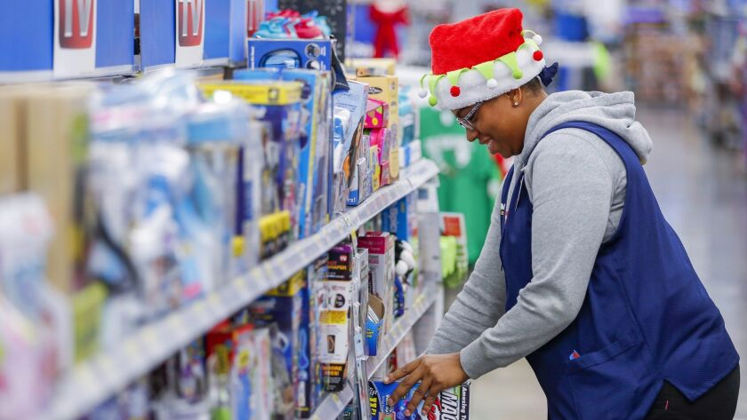 Instead of hiring holiday-season workers, Wal-Mart is asking its employees to work extra hours.