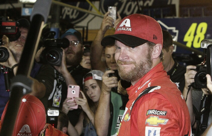 FILE - In this Nov. 19, 2017, file photo, Dale Earnhardt Jr. is surrounded upon getting out of his car after a NASCAR Cup Series auto race at Homestead-Miami Speedway in Homestead, Fla. Dale Earnhardt Jr. is returning to the track Saturday, June 13, 2020, getting behind the wheel for an Xfinity race at Homestead-Miami Speedway -- the place where his Cup Series career ended three years ago. (AP Photo/Darryl Graham, FIle)