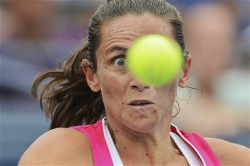 CORRECTS IDENTIFICATION OF PLAYERS TO ITALY'S ROBERTA VINCI AND POLAND'S AGNIESZKA RADWANSKA, NOT ITALY'S SARA ERRANI AND GERMANY'S ANGELIQUE KERBER - Italy's Roberta Vinci returns a shot to Poland's Agnieszka Radwanska in the fourth round of play at the 2012 US Open tennis tournament,  Monday, Sep