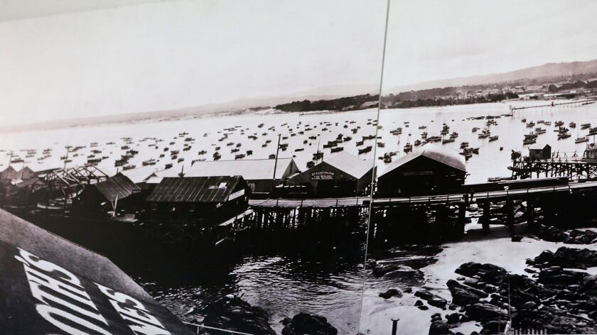 A 1919 photo of salmon and abalone fishing boats parked along Fisherman's Wharf in Monterey.