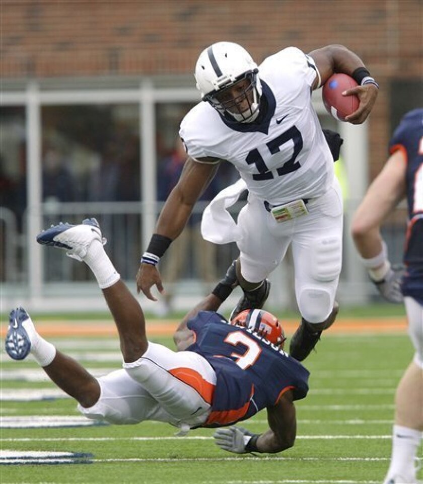 Penn State' quarterback Daryll Clark (17) runs over Illinois' Tavon Wilson (3) during the first half of the NCAA college football game in Champaign, Ill., Saturday, Oct. 3, 2009. (AP Photo/Seth Perlman)