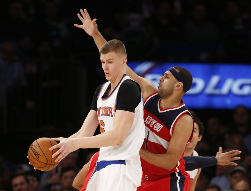 Washington Wizards forward Jared Dudley (1) defends New York Knicks forward Kristaps Porzingis (6) in the first half of an NBA basketball game at Madison Square Garden in New York, Tuesday, Feb. 9, 2016. (AP Photo/Kathy Willens)