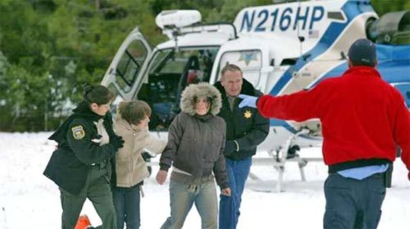 When the first helicopter landed, a girl and a boy walked into the waiting arms of emergency personnel, who whisked them into ambulances.