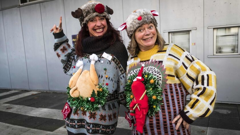 These two could go to the head of the line for boarding an Alaska Airlines flight on Dec. 21, National Ugly Christmas Sweater Day, (They were Ugly Sweater World Championship entrants earlier in December.)