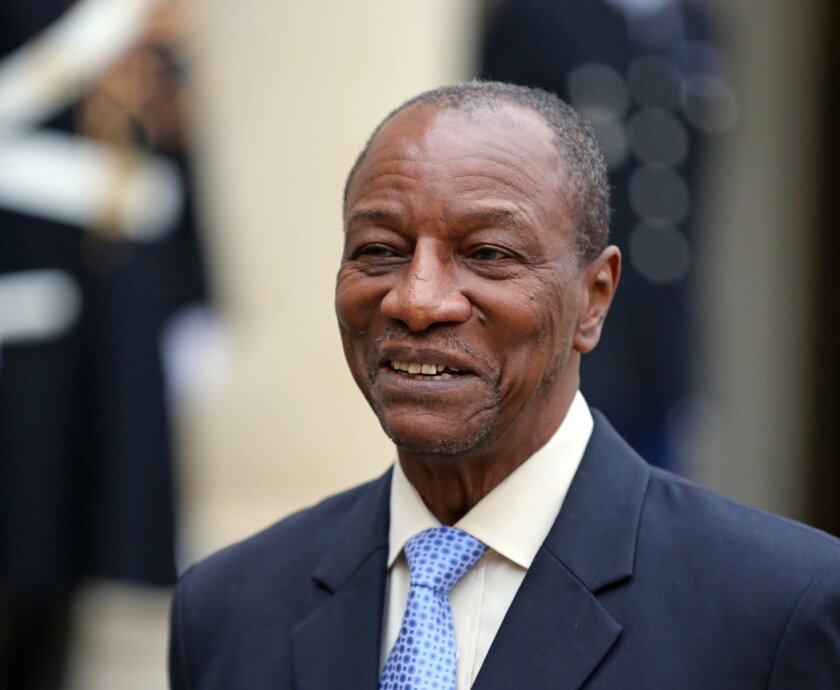 """FILE - In this Nov. 21, 2013 file photo Guinean President Alpha Conde addresses reporters following his meeting with French President Francois Hollande at the Elysee Palace in Paris. Conde says Wednesday, April 30, 2014, Brazilian mining giant Vale did nothing wrong and is free to reapply to acquire rights to one of the largest untapped iron ore deposits in the world. He says Vale """"was not part of the corruption"""" that remains under U.S. investigation and led the West African country Guinea to revoke the mining licenses for Vale and its joint venture partner, Israeli billionaire Beny Steinmetz's BSG Resources, to exploit the Simandou and Zogota deposits. (AP Photo/Remy de la Mauviniere, File)"""