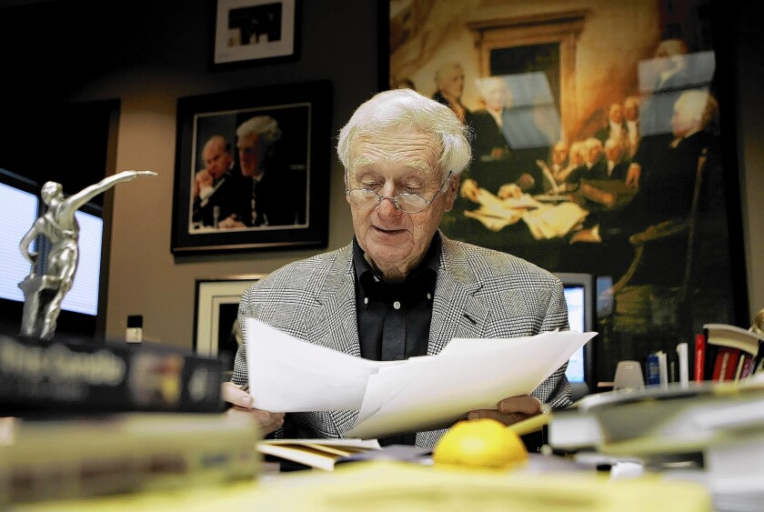 John Seigenthaler works in his office at the Tennessean newspaper in Nashville in 2005. The maverick journalist, who helped shape USA Today and championed civil rights, died Friday at the age of 86.