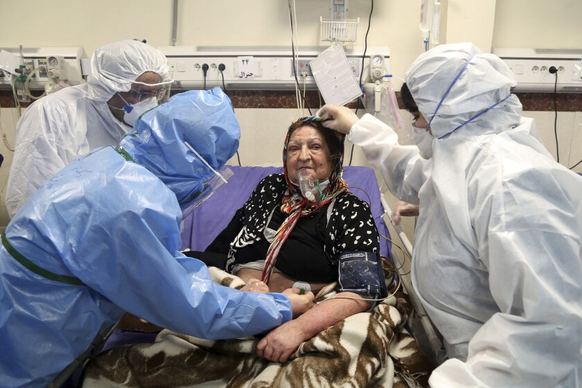 A patient infected with the coronavirus is treated at a hospital in Tehran last month. Nine out of 10 cases of the virus in the Middle East come from the Islamic Republic and fears remain that Iran may be underreporting its cases.