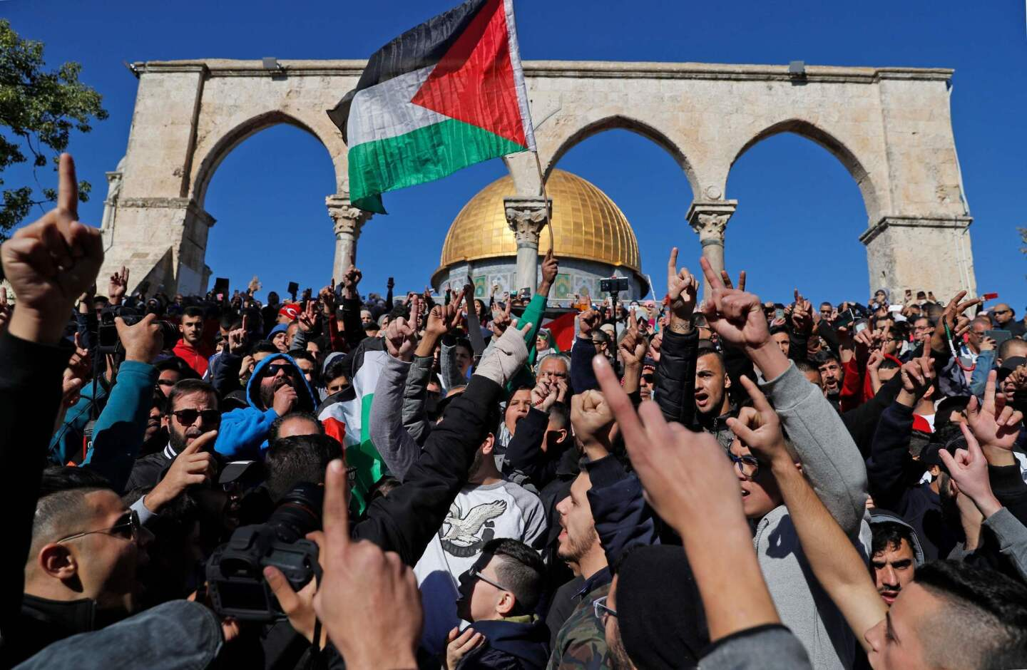 Palestinian Muslim worshipers shout slogans during Friday prayers in front of the Dome of the Rock mosque in Jerusalem's Old City. Israel deployed hundreds of additional police officers following Palestinian calls for protests after U.S. President Trump's recognition of Jerusalem as Israel's capital.