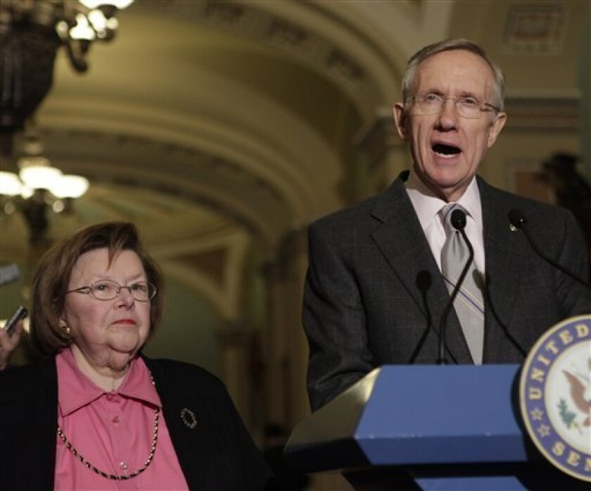 Senate Majority Leader Harry Reid of Nev., right, and Sen. Barbara Mikulski, D-Md. meet with reporters on Capitol Hill in Washington, Tuesday,Dec. 1, 2009. (AP Photo/Pablo Martinez Monsivais)