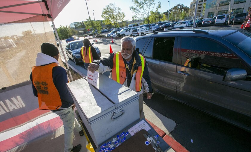 Election workers collected ballots from drive up voters at the main Registrar of Voters office in Kearny Mesa on March 3.