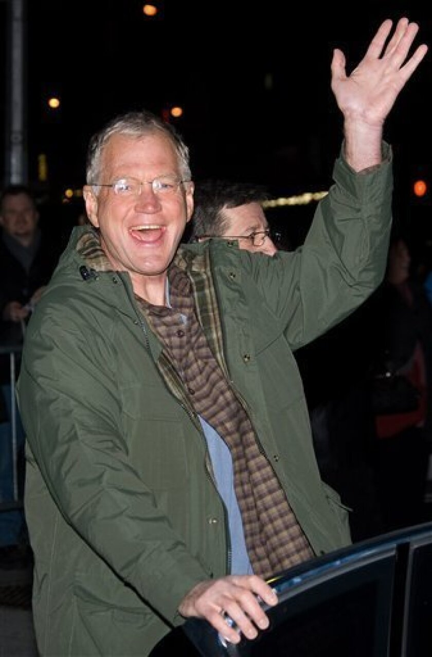 """FILE -- In a Jan. 13, 2009 file photo talk show host David Letterman leaves a taping of the """"Late Show with David Letterman,"""" in New York. Letterman Monday Dec. 7, 2009 dived right into material on Tiger Woods on the """"Late Show,"""" joking he wishes the golfer would stop asking him for advice. (AP Photo/Charles Sykes)"""