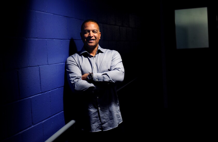 Dodgers new manager Dave Roberts stands near the clubhouse at Dodger Stadium before the start of the 2016 season.