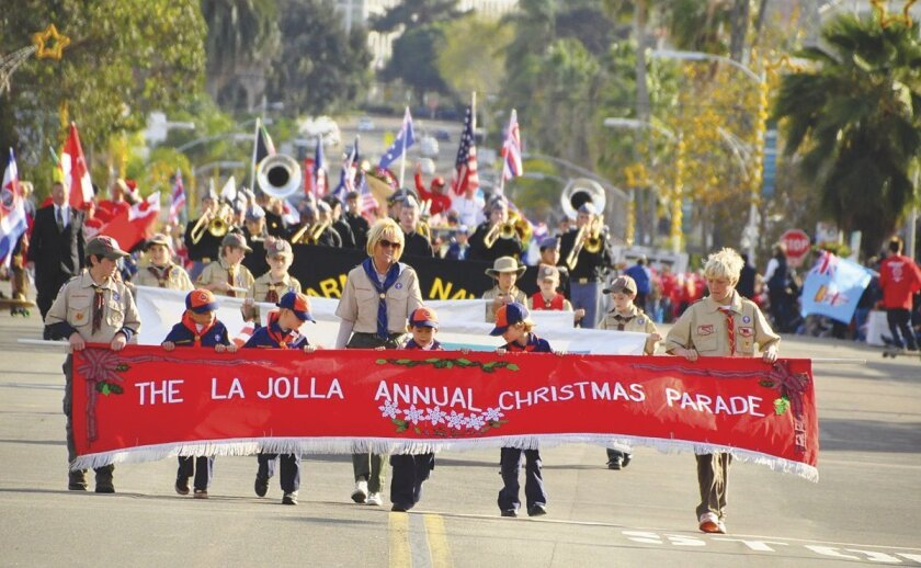 An opening scene from the 56th annual La Jolla Christmas Parade down Girard Avenue on Dec. 8, 2013.  Greg Wiest