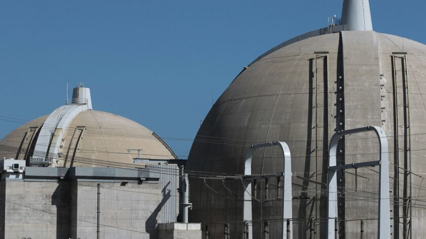 A 2016 file photo of the Unit 2, right, and Unit 3 reactor containment structures at the San Onofre Nuclear Generating Station. Small amounts of asbestos have been found in both structures.