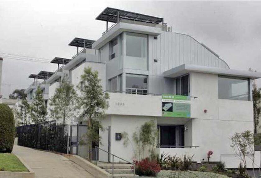CHANGING THE LANDSCAPE: Architect Jesse Bornstein's five-unit town home project on 19th Street in Santa Monica -- called Green on 19 -- incorporates more environmentally friendly features than most multifamily housing developments that market themselves as green. Solar panels, for example, are an integral part of the architectural design. The low-water landscaping is dotted with kangaroo paw and black acacia trees. More... • In Santa Monica, architect Jesse Bornstein builds a split-level home for modern living Also in Home & Garden • New looks in wicker, rattan and other woven furniture • Guerrilla gardeners take root in Southern California • How to make seed bombs • Eye Candy: Home & Garden Photo Galleries
