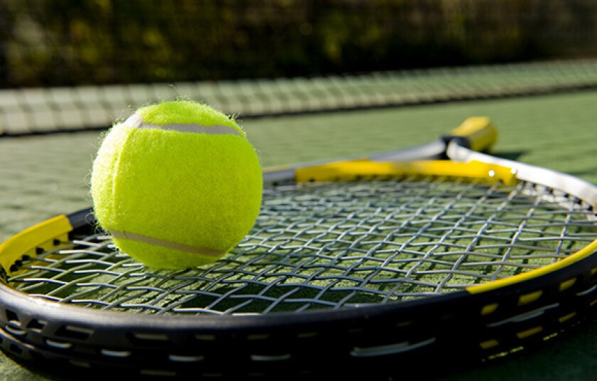 A tennis racket and new tennis ball.