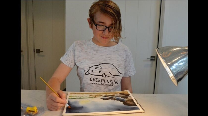 Art student, Millie Hamel works on a watercolor paining during her in home lesson.