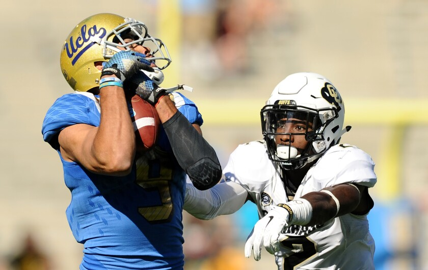 UCLA receiver Jordan Payton makes a catch in front of Colorado defensive back Ken Crawley during the third quarter of a game at the Rose Bowl on Oct. 31.