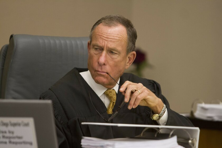 Superior Court judges such as John Meyer, shown here listening to testimony in the Encinitas schools yoga curriculum trial in May, are getting raises. [U-T file]