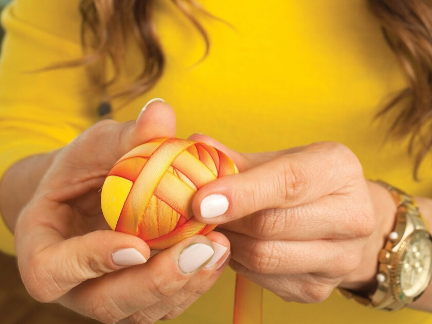 Sabrina Soto wrapped this egg in an elegant ribbon.