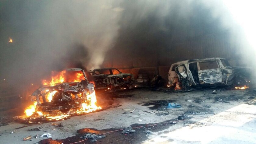 Vehicles burn, that authorities say caught fire during a gunbattle, in a warehouse at Rancho del Sol, near Ecuanduero, in western Mexico, Friday, May 22, 2015. At least 43 people died Friday in what authorities described as a fierce, three-hour gunbattle between federal forces and suspected drug gang gunmen at the ranch. (AP Photo/Oscar Pantoja Segundo)