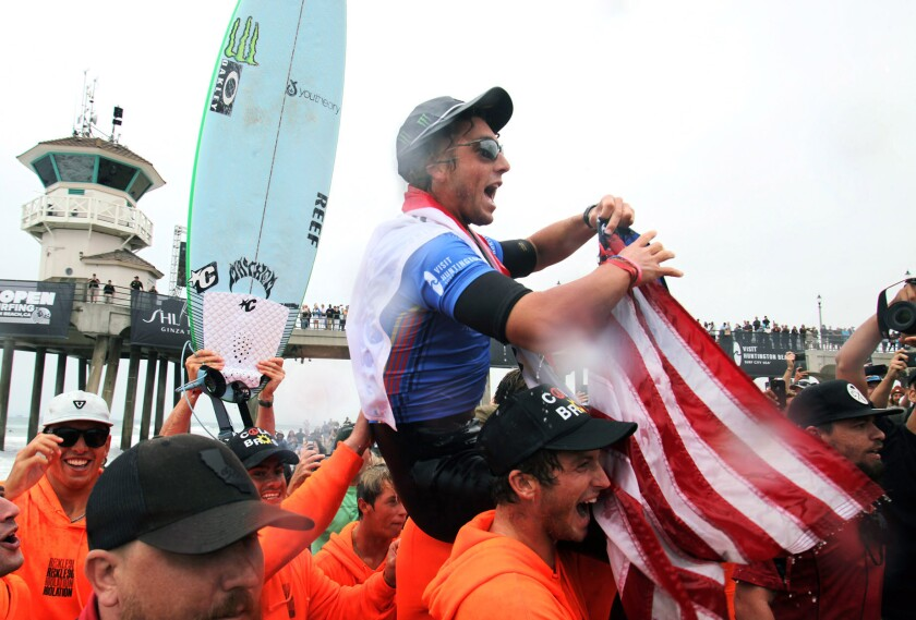 Griffin Colapinto is carried off the beach after winning the men's 2021 U.S. Open of Surfing on Sunday in Huntington Beach.
