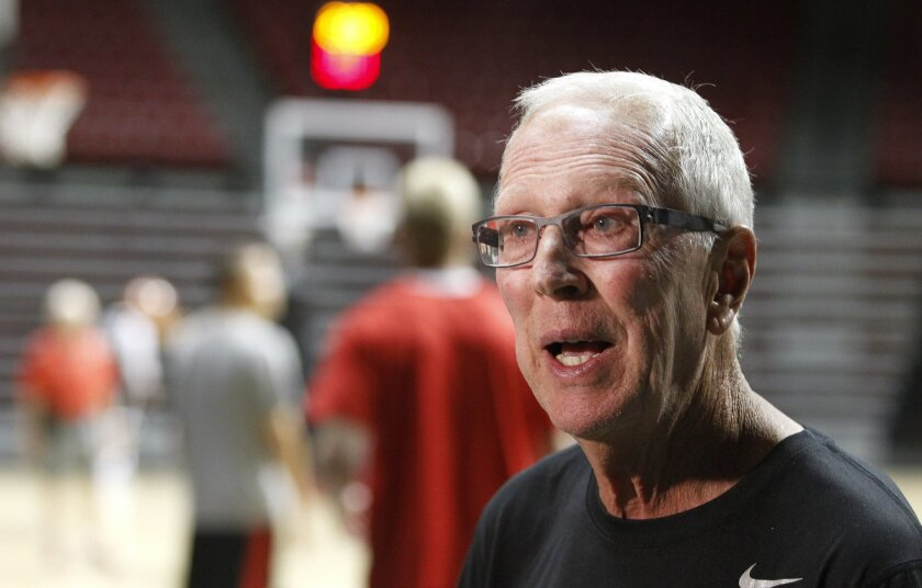The Aztecs' head basketball coach Steve Fisher talk to the media before the start of the Aztecs first basketball practice.