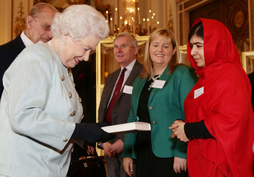 """Malala Yousafzai gave her book """"I Am Malala"""" to England's Queen Elizabeth II; now it is being banned in Pakistan, her home country."""