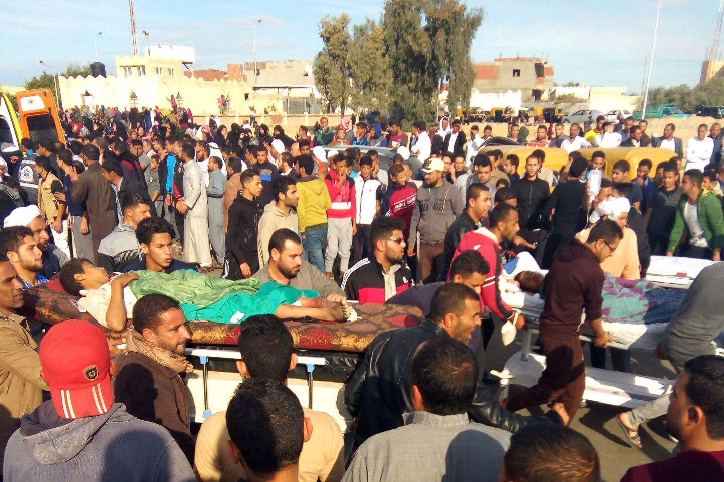 Egyptians carry victims on stretchers after an attack on the Rawda mosque near the North Sinai provincial capital of Arish.