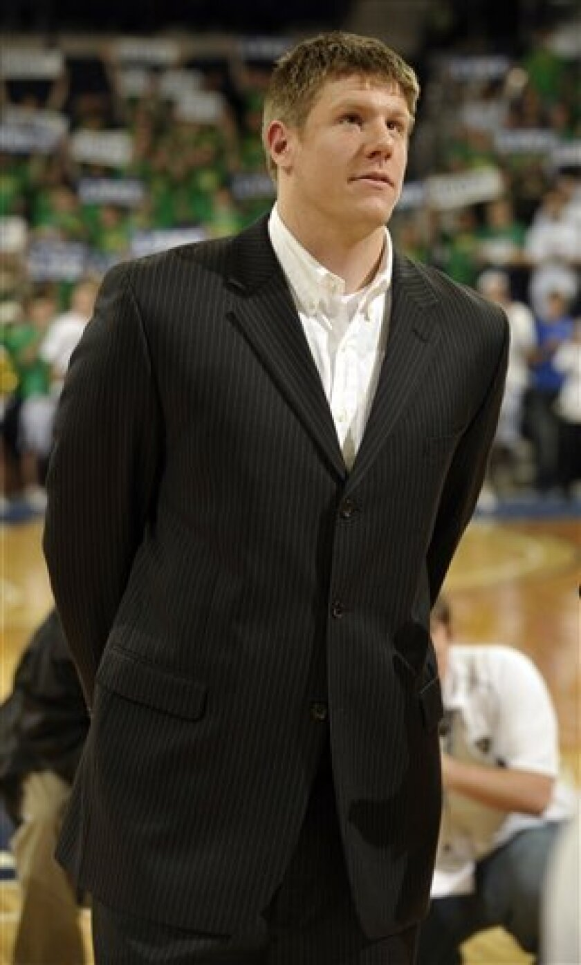 Notre Dame forward Luke Harangody watches a ceremony honoring him before an NCAA college basketball game between Notre Dame and Pittsburgh on Wednesday, Feb. 24, 2010, in South Bend, Ind. The injured Harangody did not play in the game. (AP Photo/Joe Raymond)