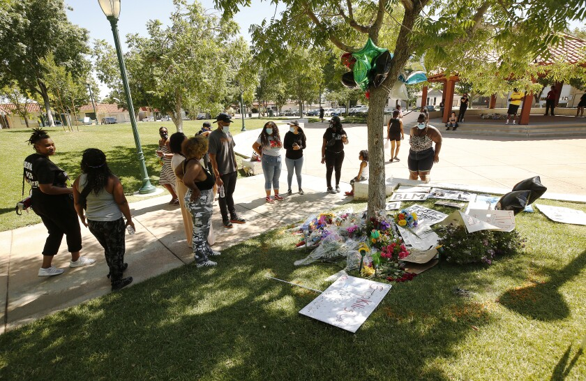 People gather at a memorial for Robert Fuller by Palmdale City Hall, where the young Black man was found hanging from a tree.