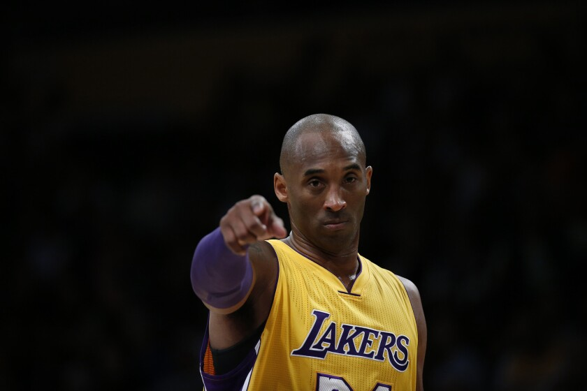 Kobe Bryant directs his teammates during a game against the Timberwolves on Feb. 2.