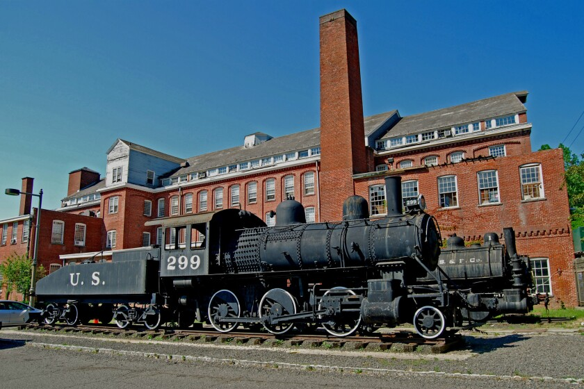 Rogers locomotives are displayed outside the former Rogers Locomotive and Machine Works erecting shop. No. 299 helped build the Panama Canal.