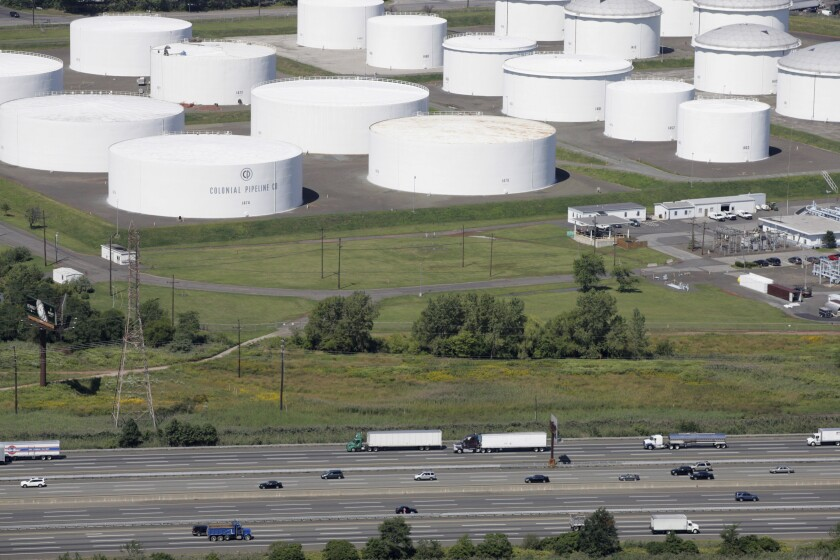 Traffic on I-95 passes oil storage tanks owned by the Colonial Pipeline Company in Linden, N.J.