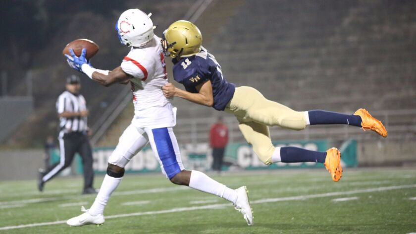 Vincent Memorial's Ivan Avalos (right) breaks up a pass intended for Crawford's Ali Musavs.