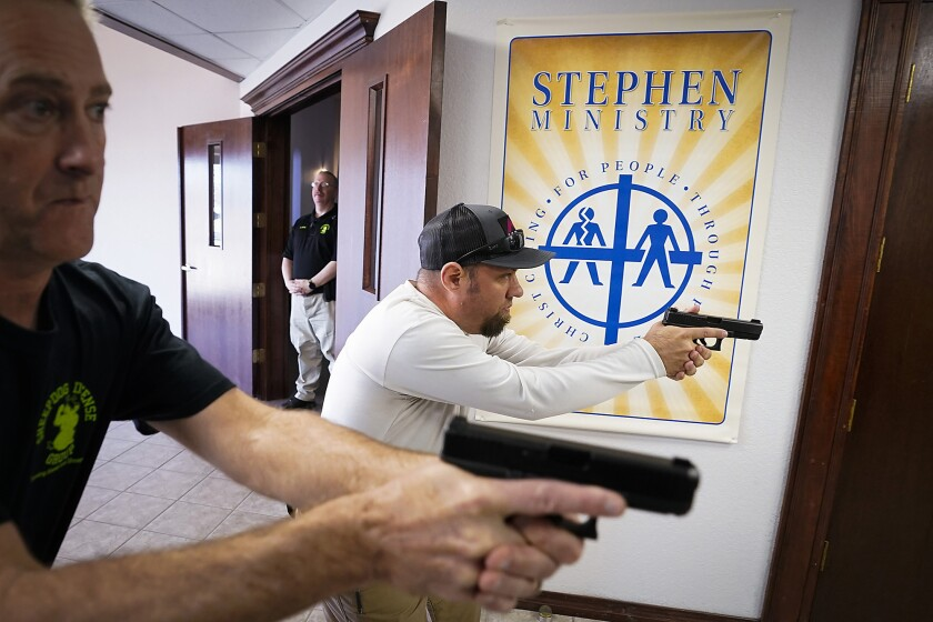 Churchgoers practice clearing a hallway during armed security training in Texas