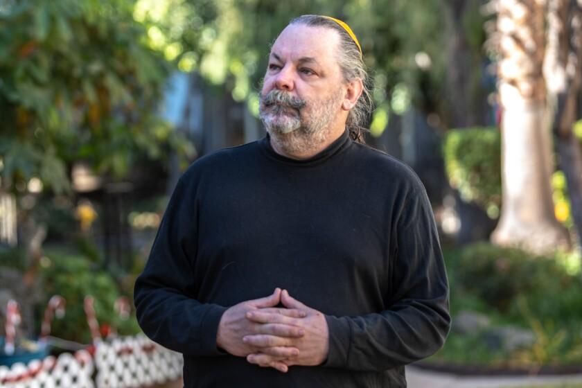 Richard Lantz posed outside his Spring Valley residence Friday