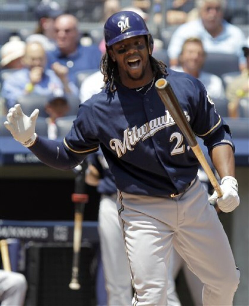 Milwaukee Brewers' Rickie Weeks reacts after striking out during the first inning of an interleague baseball game against the New York Yankees Thursday, June 30, 2011, at Yankee Stadium in New York. (AP Photo/Seth Wenig)