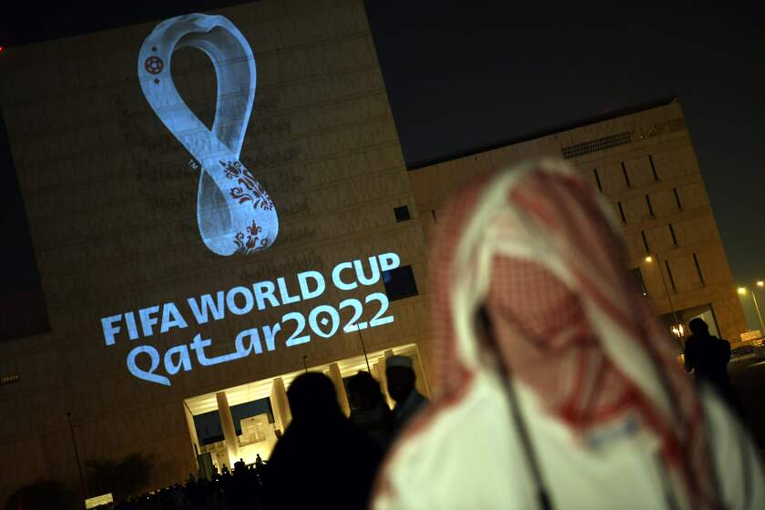 People gather at the capital Doha's traditional Souq Waqif market while the official logo of the FIFA World Cup Qatar 2022 is projected on the front of a building on September 3, 2019. (Photo by - / AFP)-/AFP/Getty Images ** OUTS - ELSENT, FPG, CM - OUTS * NM, PH, VA if sourced by CT, LA or MoD **