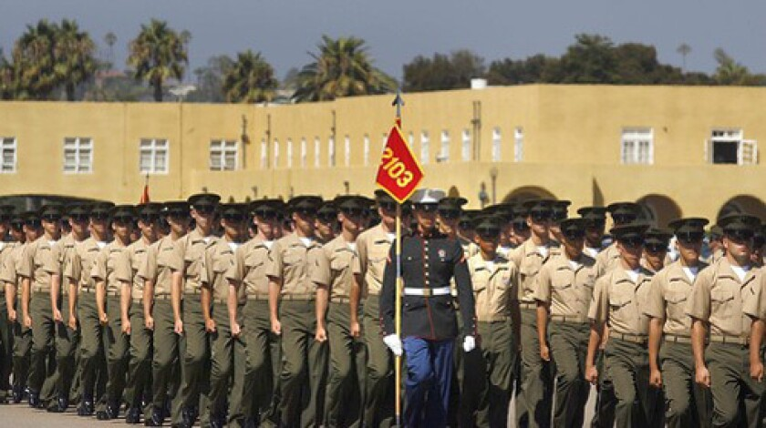 Marine recruits from Platoon 2103 march in a ceremony during which they are each awarded the eagle, globe and anchor - the official emblem of the United States Marine Corps.
