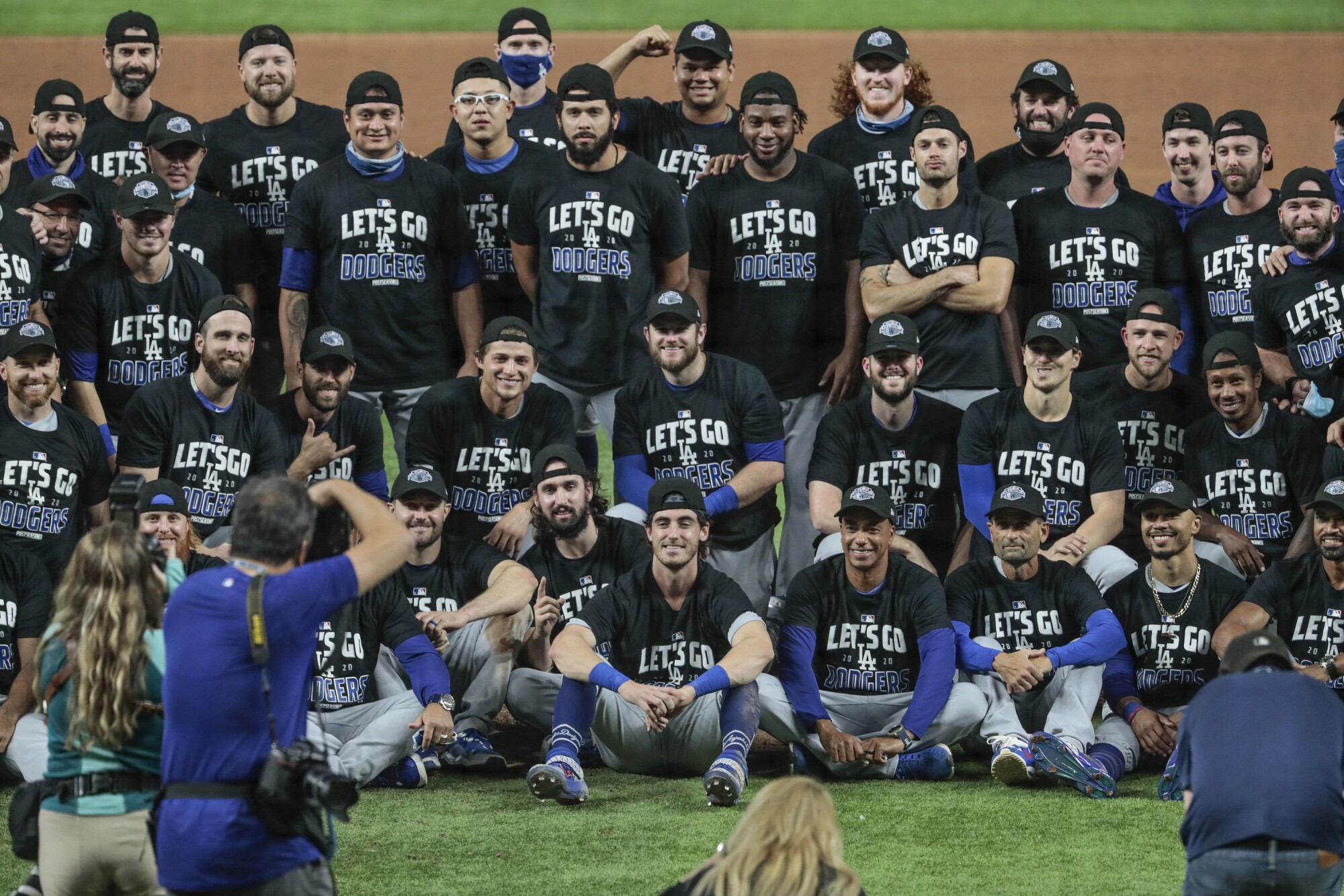 Dodgers players celebrate at Globe Life Field in Arlington, Texas, after sweeping the San Diego Padres.