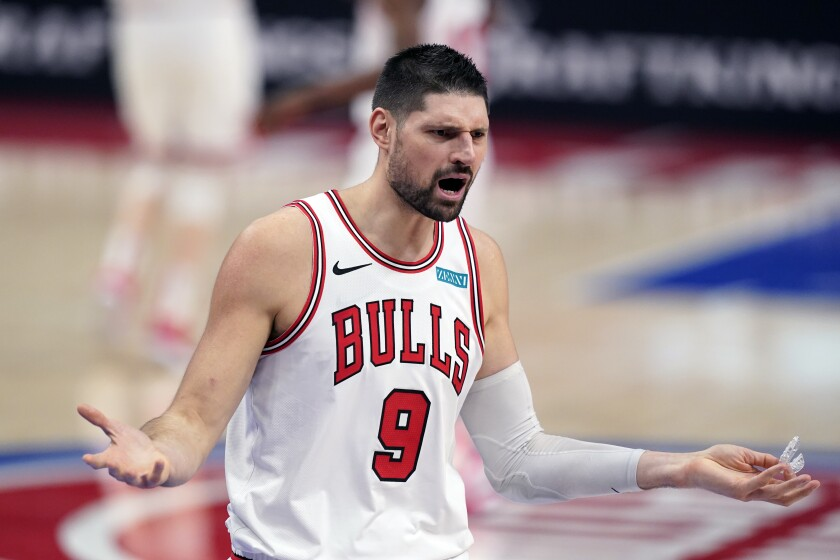 Chicago Bulls center Nikola Vucevic reacts after a foul during the second half of an NBA basketball game against the Detroit Pistons, Sunday, May 9, 2021, in Detroit. (AP Photo/Carlos Osorio)