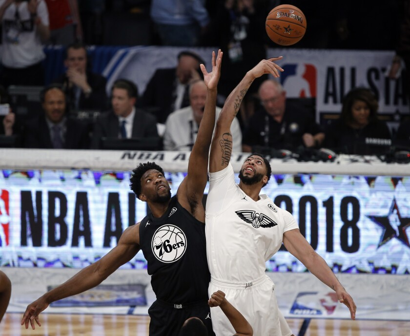 FILE - In this Feb. 18, 2018. file photo, Team Stephen center Joel Embiid, left, of the Philadelphia 76ers. leaps for the tipoff won by Team LeBron forward Anthony Davis, of the New Orleans Pelicans, during the NBA All-Star basketball game in Los Angeles. The NBA has changed the format of its All-Star Game and basketball purists are skeptical. The betting industry is curious. The changes could spark more in-game betting, which is popular in Europe but not as much in the U.S. Or, perhaps bettors will sit this one out, unsure of what to expect. (AP Photo/Alex Gallardo, File)