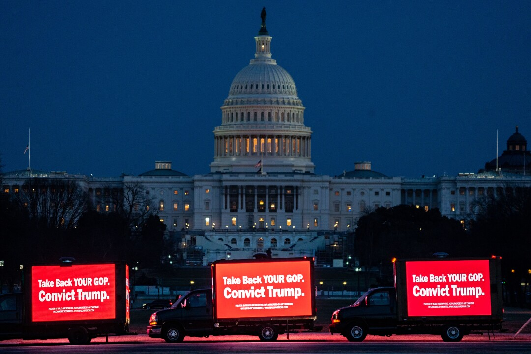 Trucks with LED screens displaying anti-Trump messages near the Capitol Building