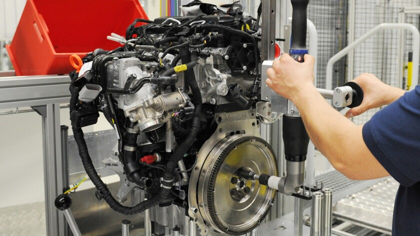 A worker with a diesel engine at a Volkswagen plant in Salzgitter, Germany.