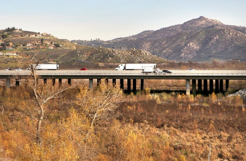 View of the I-15 bridge passing over the dried-up eastern section of Lake Hodges in this view looking east. In the distance at upper right is Starvation Mountain.