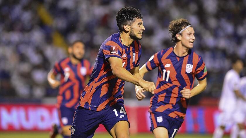 Ricardo Pepi (left) celebrates with Brenden Aaronson after scoring a goal during match against Honduras.