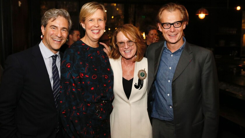 Los Angeles County Museum of Art Director Michael Govan, from left, Broad Founding Director Joanne Heyler, Hammer Museum Director Ann Philbin and Museum of Contemporary Art Director Philippe Vergne attend the post-exhibit-preview dinner at Otium in Los Angeles.
