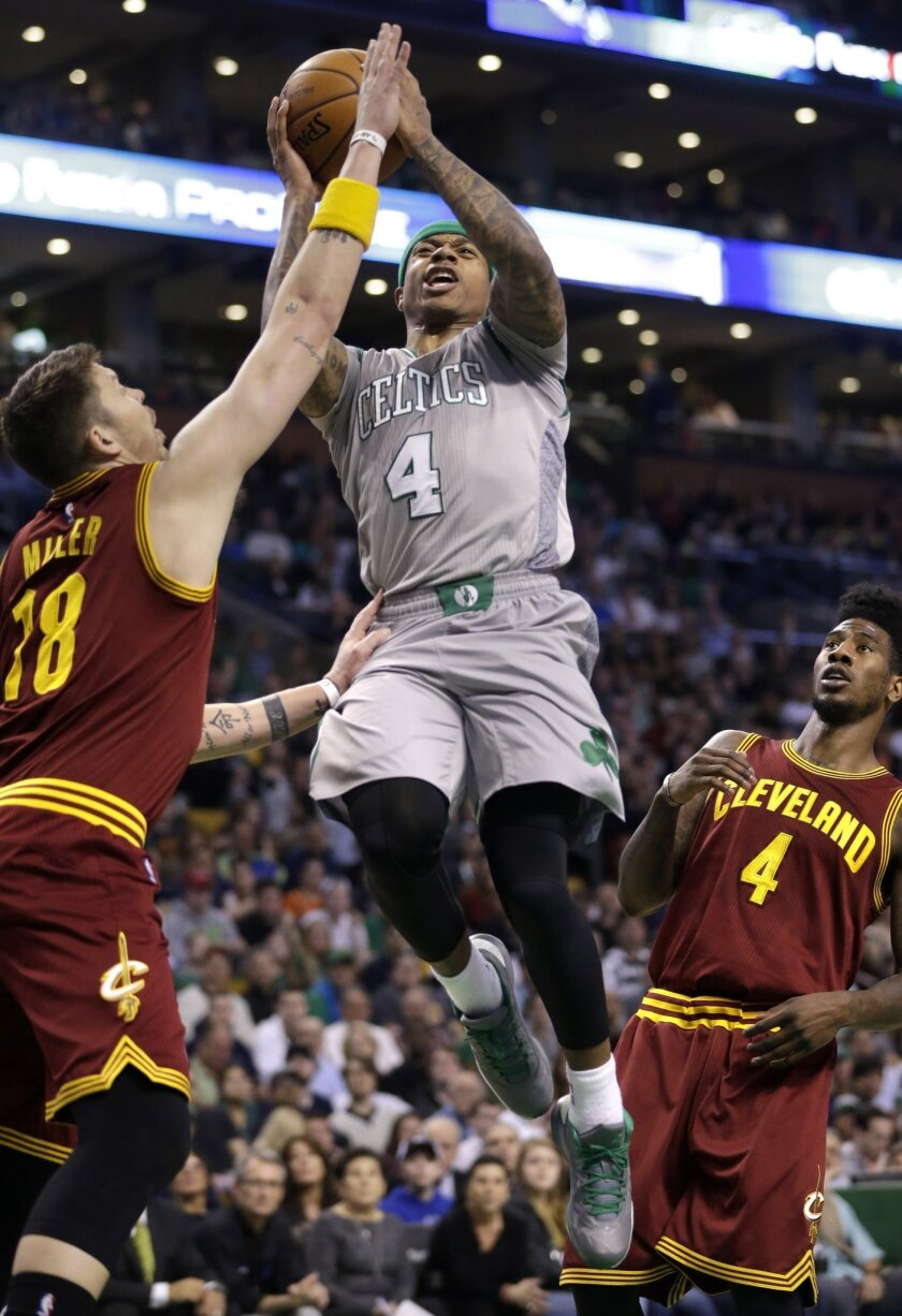 Boston Celtics guard Isaiah Thomas (4) against Cleveland Cavaliers guard Mike Miller (18) as Cavaliers guard Iman Shumpert (4) looks on during the first quarter of an NBA basketball game Sunday, April 12, 2015, in Boston. (AP Photo/Steven Senne)